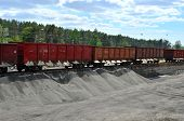 Unloading Of Crushed Stone From Railway Car. Unloading Bulk Cargo From Railway Wagons On Of High Rai poster