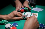 Poker Player Bets All Chips. Big Poker Risks. Poker Table And Hands Close-up poster