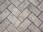 pic of driveway  - Close up of a pattern of brick pavers on a driveway - JPG