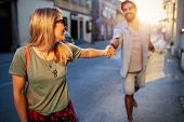 Traveling Couple Of Tourists Walking Around Old Town. Vacation, Summer, Holiday, Tourism Concept poster