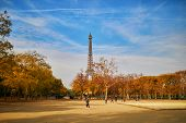 People Jogging Near The Eiffel Tower In Paris, France On A Nice And Bright Autumn Day In Paris, Fran poster