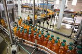 Plastic Bottles With Juice On Automated Conveyor Line Or Belt In Modern Beverage Plant Or Factory Pr poster