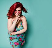 Plus-size Overweight Redhead Lady Plus-size Woman In Sunglasses Shows Shhh Gesture Sign With Her Fin poster
