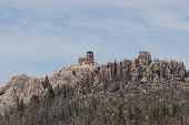Black Elk Peak ( Formerly Harney Peak) And Tower Which Overlooks Eroded Rock Formations And A Dying  poster