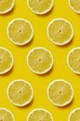 Fresh sliced lemon on yellow background, infinite pattern. Seamless background of fresh lemon slices poster