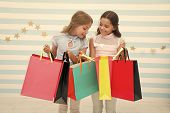 Shopping With Best Friend Concept. Girls Like Shopping. Kids Happy Small Girls Hold Shopping Bags. E poster