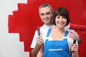 stock photo of interior decorator  - Couple painting their house - JPG