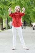 Fun And Play All Day. Cute Little Girl Gesturing Thumbs Ups Playing Outdoor. Adorable Small Child En poster
