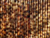 Brown Bamboo Background Wall Fence Texture, Asia Traditional Pattern. Dark Brown Color Bamboo Stick  poster