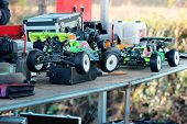 Rc Racing Cars During Race Offroad Track poster