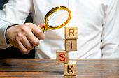 A Man Explores A Tower Of Cubes With The Word Risk. Search And Correction Of Errors And Failures. Ri poster