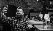 Man Bearded Hipster Hold Smartphone. Taking Selfie Concept. Online Communication. Send Selfie To Fri poster