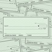 A pile of blank checks with a single check on top in straight layout with open spacing for you to pl