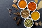 Spices In Little White Bowls On Black Slate Background - Indian Spice Top View Photo With Space For  poster