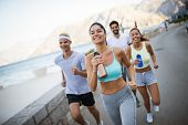 Group Of Young People Jogging And Running Outdoors In Nature poster