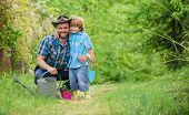 Spring Garden. Dad Teaching Little Son Care Plants. Little Helper In Garden. Planting Flowers. Growi poster