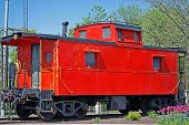 pic of caboose  - Bright red caboose in the train station - JPG