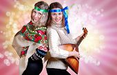 foto of mummer  - Two russian beauties with folk attributes on the pink background - JPG