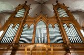 foto of pipe organ  - Beautiful organ with a lot of pipes angle shot - JPG