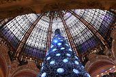 PARIS - NOVEMBER 11: The Christmas tree at Galeries Lafayette, trade pavilions with perfume, Novembe