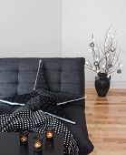 foto of futon  - Living room decorated with cozy lights and candles - JPG