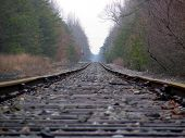 stock photo of train track  - long level photo of train tracks - JPG