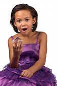 picture of jaw drop  - A young girl drops her jaw in awe whilst holding a large diamond in her hand - JPG