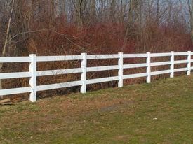 picture of white vinyl fence  - split rail style vinyl fencing - JPG
