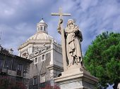 statue of St. Agatha and cupola of Saint Agatha Abbey where she is buried. She is the patron saint o