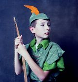 stock photo of fletching  - Young Robin Hood with an English long bow - JPG