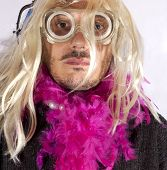 stock photo of hermaphrodite  - Man with blonde wig and fuchsia boa - JPG