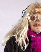 pic of hermaphrodite  - Man with blonde wig and fuchsia boa - JPG