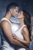 image of nake  - Beautiful young smiling couple in love embracing kissing - JPG