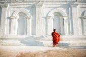 stock photo of southeast asian  - Southeast Asian young little Buddhist monks walking morning alms in Inle - JPG