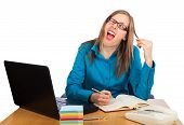 stock photo of mimicry  - Young businesswoman is fed up with work  - JPG