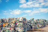 stock photo of discard  - Dump with processed garbage with blue sky as backgrond  - JPG
