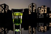 picture of absinthe  - Absinthe shot in nice cityscape setting  - JPG