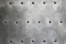 picture of stelles  - Black grunge metal plate or armour texture with rivets as background - JPG