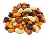 stock photo of mixed nut  - Mixed nuts and dry fruits pile isolated on white background - JPG