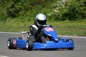 stock photo of karts  - A speeding go-kart. ** Note: Slight blurriness, best at smaller sizes - JPG