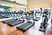 stock photo of treadmill  - Set of treadmills staying in line in the gym - JPG