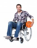 stock photo of paralympics  - Man in wheelchair with basketball - JPG