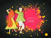 stock photo of holi  - Beautiful Indian colours festival Holi concept with young couple in traditional outfits dancing and playing colours on splash background - JPG