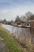 stock photo of houseboats  - Houseboats in the Netherlands on a rural canal - JPG
