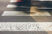 stock photo of pedestrian crossing  - Pedestrian crossing with blurred fast car danger city - JPG