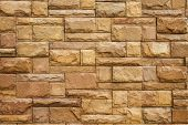 stock photo of cobblestone  - construction texture of brick stone wall for exterior background - JPG