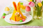 stock photo of easter candy  - Festive table setting with Easter bunny napkin - JPG