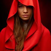 stock photo of cloak  - beautiful woman with red cloak in studio - JPG