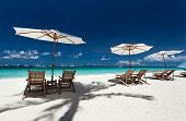 stock photo of beachfront  - Sun umbrellas and beach chairs on tropical beach Philippines Boracay - JPG