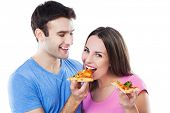 picture of take out pizza  - Young couple eating pizza - JPG